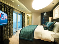 Norwegian Getaway - The Haven Deluxe Owner's Suite, Schlafzimmer